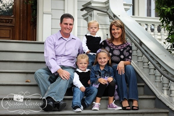 Family in purple and black with jeans