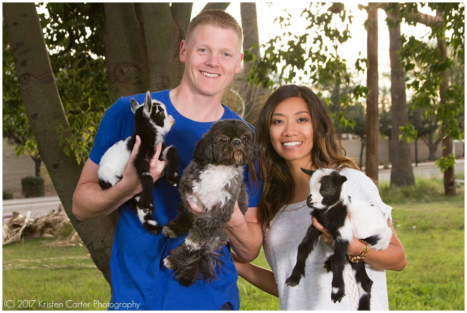 Engagement photos with baby goats and dog in Gilbert AZ